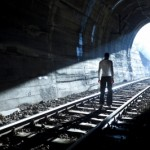 Man Standing In Train Tunnel by adamr